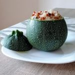 Round zucchini filled with quinoa and lentils