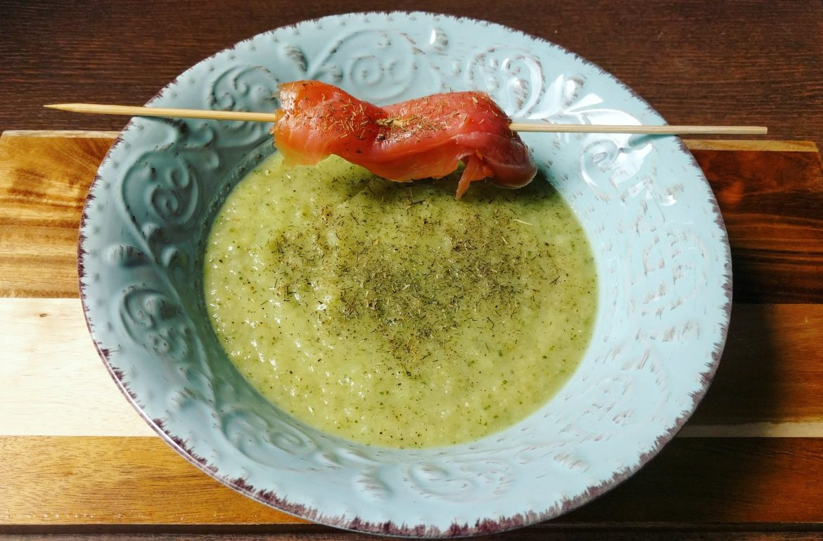 Green soup with dill and smoked salmon skewer
